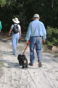 A couple walks their dog on the Sweetwater Preserve trail