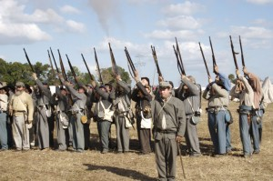 Living history reenactors fire rifles